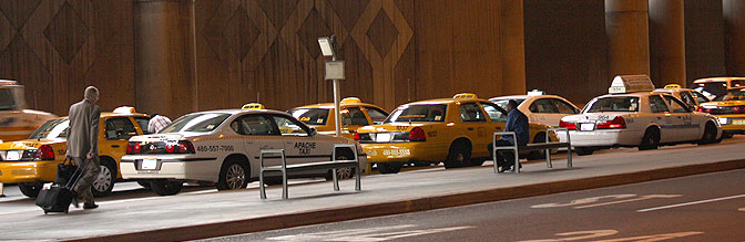 Taxis waiting at the curb