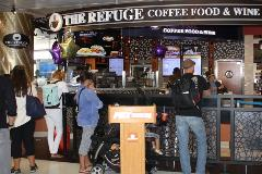 You'll find great coffee, specialty drinks, baked goods, sandwiches, and wine at the Refuge Coffee Food and Wine. Its roasted coffee beans are imported from countries in Africa, Latin America and the Pacific Rim, among others.